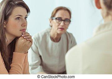 Spiritual guide talking with women - Mature spiritual guide...