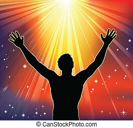 Spiritual joy - A man with arms raised to heaven. Conceptual...
