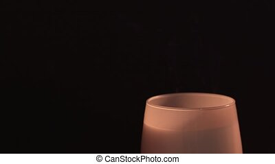 Spiritual session - a woman blows out a burning candle. Isolated, black background. The concept of religion, faith, magic and witchcraft 4k