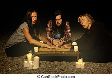 Spiritual women in outdoor session with ghosts