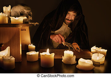 Spiritualist with ouija board in ghost session
