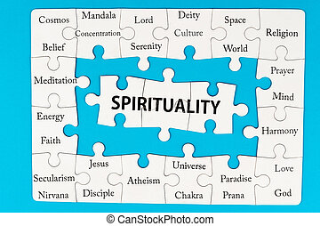 Spirituality concept words on group of jigsaw puzzle pieces