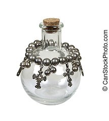 Spirituality potion shown by silver crosses hanging from a glass bottle - path included