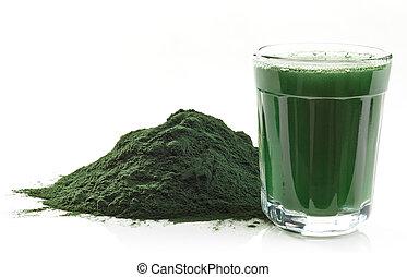 Spirulina algae powder - Stack of spirulina algae powder and...