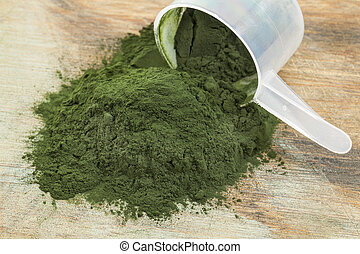spirulina powder scoop - Hawaiian spirulina powder spilling...