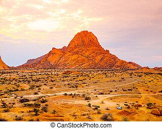 Spitzkoppe, aka Sptizkop - unique rock formation of pink granite in Damaraland landscape, Namibia, Africa