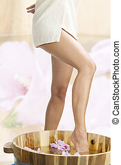 splash - close up of legs of a girl wearing beige towel