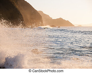 Splash in a beach of Spain