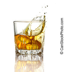 Splash in glass of whiskey and ice isolated on white ...