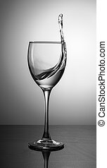 splash of clear clear water in a glass on a gradient background
