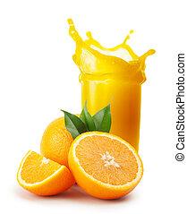 Splash of orange juice and oranges with leaves