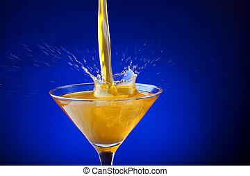 Splash of orange juice on a blue background