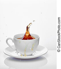 Splash of tea in the cup isolated on white