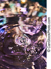 Splash of water from falling Kali, circles on the water, abstract pattern, frozen water splashes.
