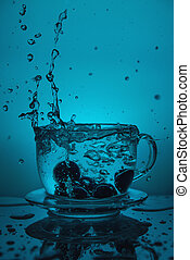 Splash of water in a cup