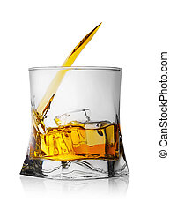 Splash of whiskey with ice in glass
