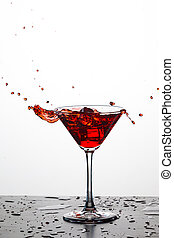 Splash Photography of Red Wine Drops Against White Background. Vertical Image
