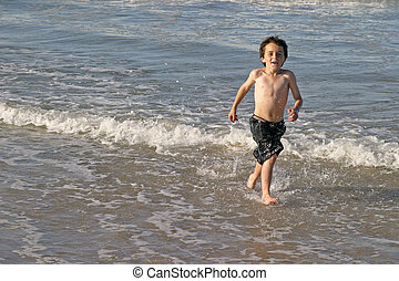 Splashing About In t - A young child splashing about in the...