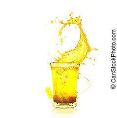 splashing brewing tea on white