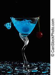 Splashing cocktail with cherry