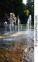 splashing dancing fountains in park. Podebrady