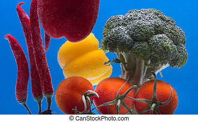 Splashing fruit on water. Fresh Fruit and Vegetables being...