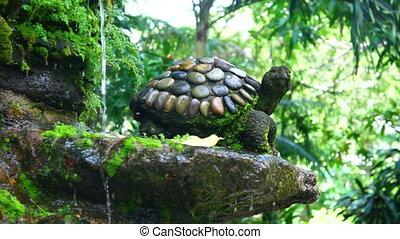 Splashing Garden Fountain with a stone turtle.