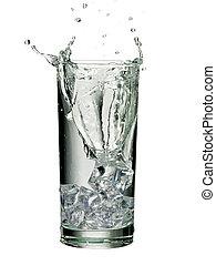 splashing glass of water with ice