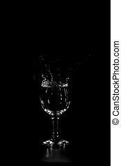 splashing in a glass