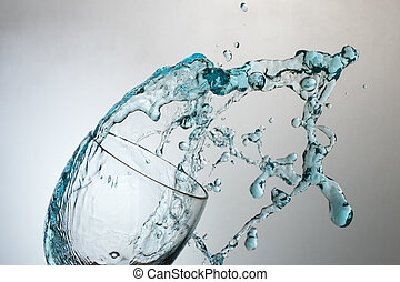 Splashing into glass of water