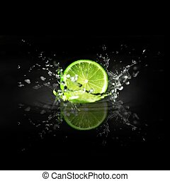 splashing cutted lime on a black background