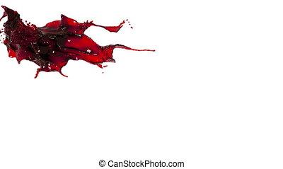 splashing spilling red fluid in slow motion. oil