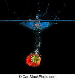splashing strawberries