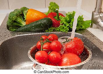 Splashing vegetables - Fresh vegetables splashing in water...