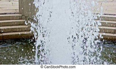 Splashing water of park fountain