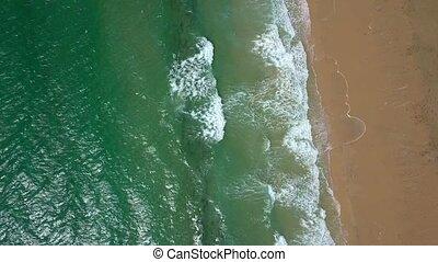 Splashing water washing sand - From above aerial shot of...