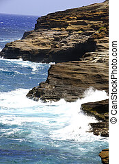 Waves splashing on the cliffs and lava rocks on the Island of Oahu in Hawaii.