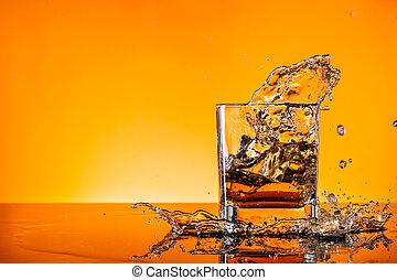 Splashing whiskey - Glass of whiskey splashing out