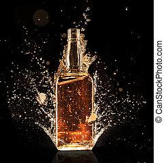 Splashing whiskey - Isolated shot of whiskey with splash on...