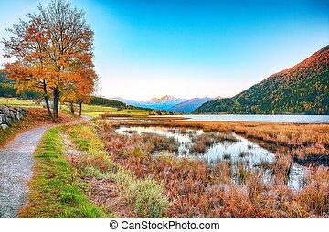 Splendid autumn panorama of Haidersee (Lago della Muta) lake...