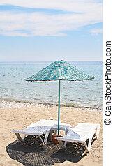 Splendid parasol and beach in resort.