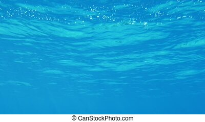 Splendid sea surface shot underwater with playful sparkles...