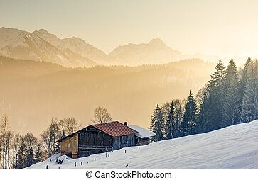 Splendid view from wooden cabin to the alpine mountains of Allgau Alps, Bavaria, Germany.