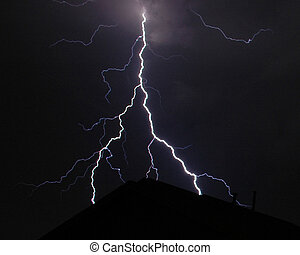 Split lightning strike over a residential roof top