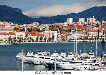 Split cityscape on the Adriatic Sea in Croatia, motorboat harbor in the foreground