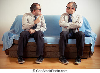 Man with split personality sitting on a couch
