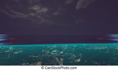 Split view over and under water in the Caribbean sea with clouds
