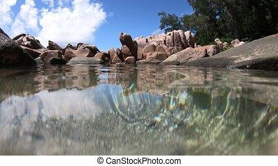 Split view sea of Seychelles natural pools - La Digue,...