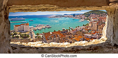 Split waterfront aerial panoramic view through stone window