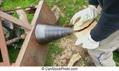 Splitting Wood - Conical Firewood Wood Log Splitter